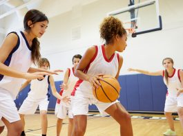 Females playing Basketball
